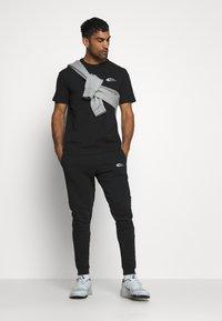Smilodox - Teplákové kalhoty - schwarz - 1