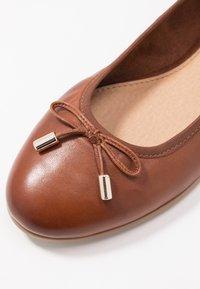 s.Oliver - 5-5-22112-24 - Ballet pumps - cognac - 2