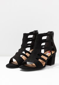 s.Oliver - Ankle cuff sandals - black - 4
