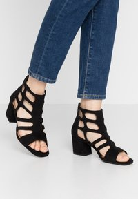 s.Oliver - Ankle cuff sandals - black - 0