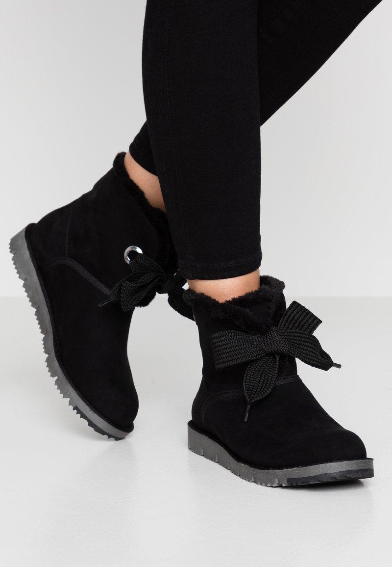 s.Oliver - Kotníkové boty - black