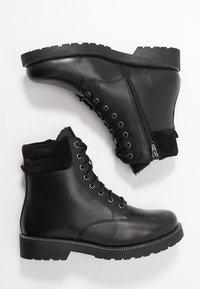 s.Oliver - Kotníkové boty na platformě - black - 3