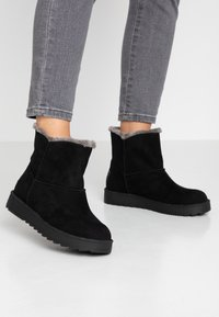 s.Oliver - Winter boots - black - 0