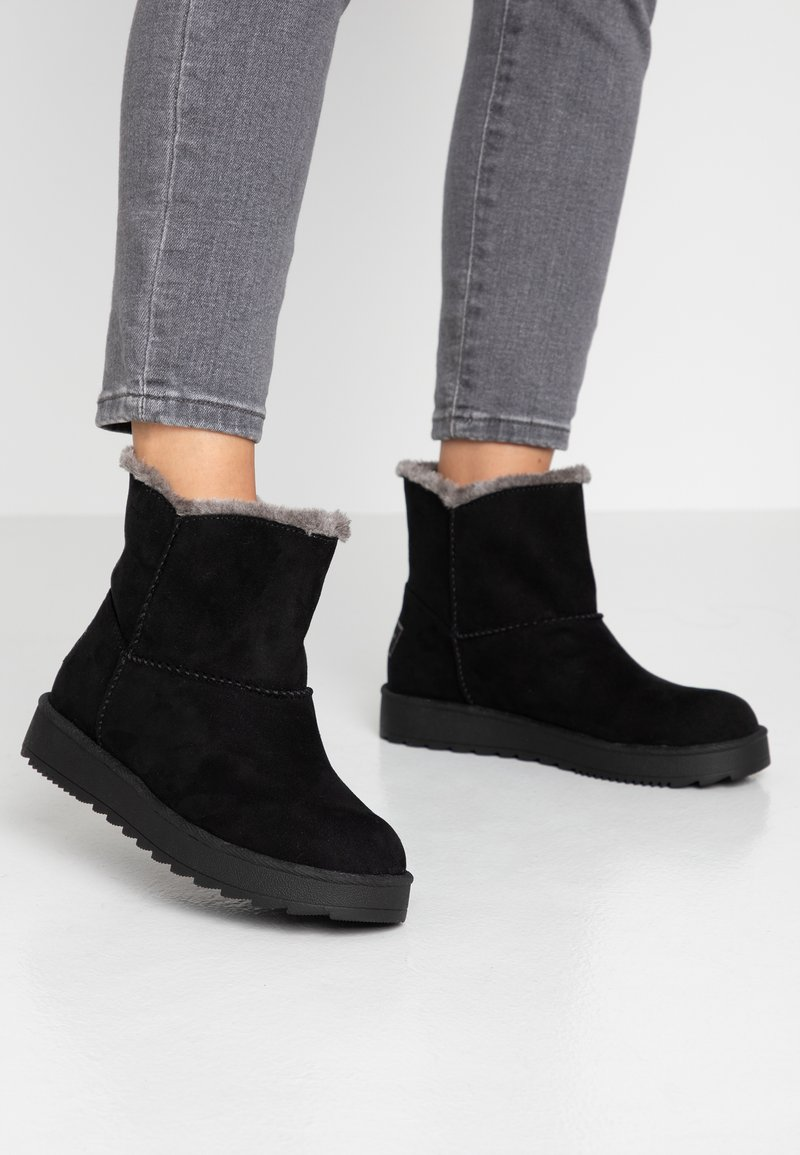 s.Oliver - Winter boots - black