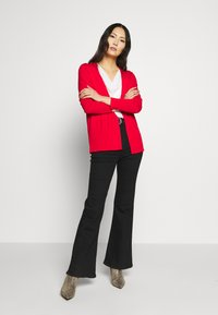 s.Oliver - Cardigan - luminous red