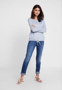 s.Oliver - SHAPE - Slim fit jeans - blue denim - 1