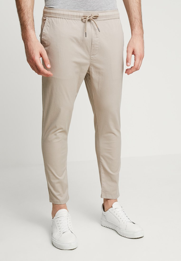 Solid - TRUC CROPPED - Trousers - sand