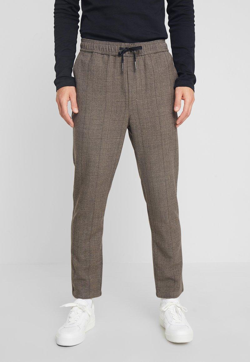 Solid - SLIM TRUC CHECKS - Trousers - pumpkin
