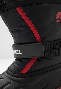 Sorel - YOUTH FLURRY - Zimní obuv - black/bright red - 2