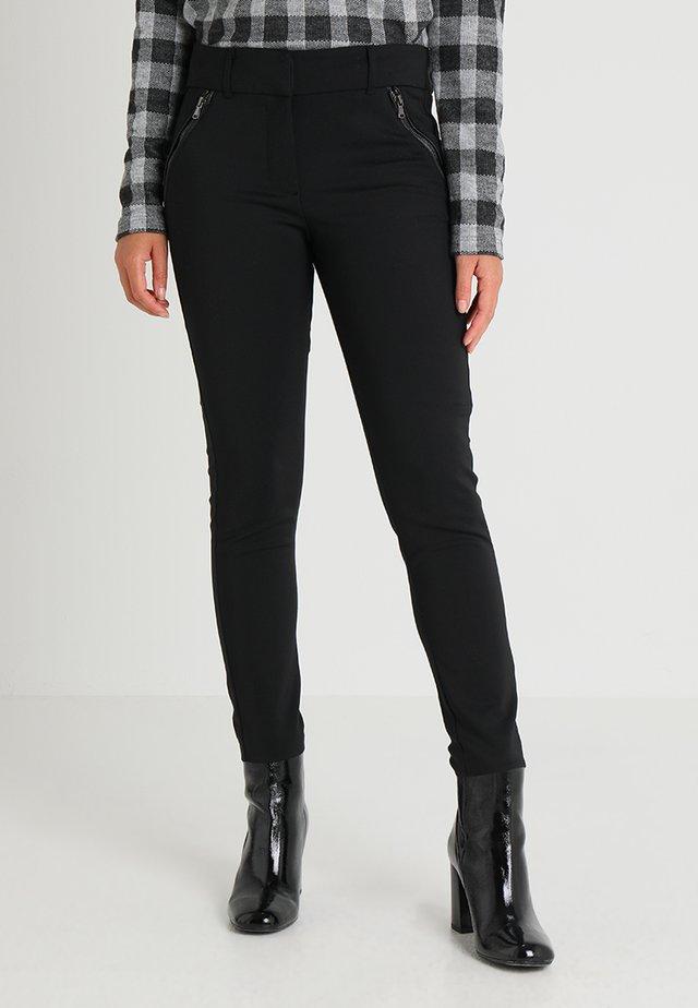 NIGERIA - Trousers - black