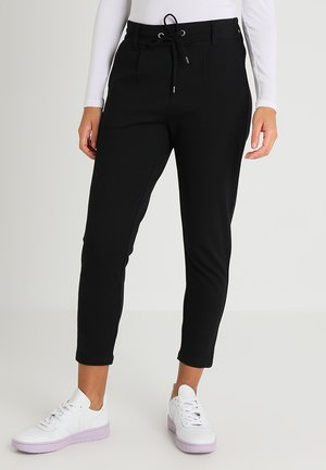 ASALI - Tracksuit bottoms - black