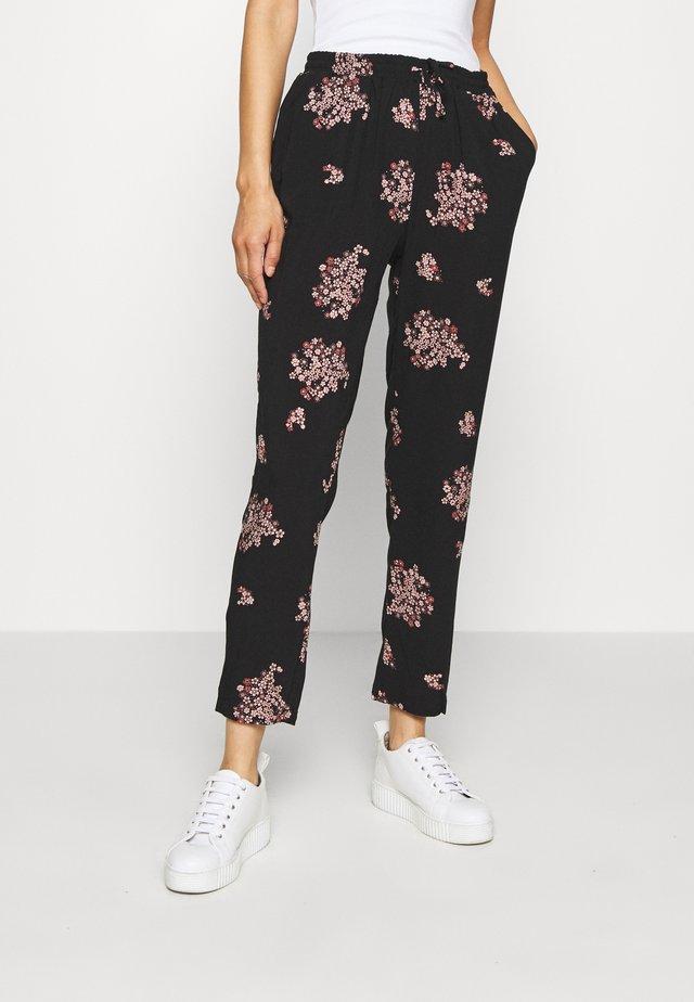 KASIA  - Trousers - black/combi