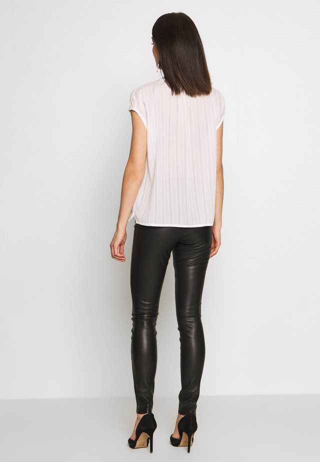 KAYLEE - Leggings - black