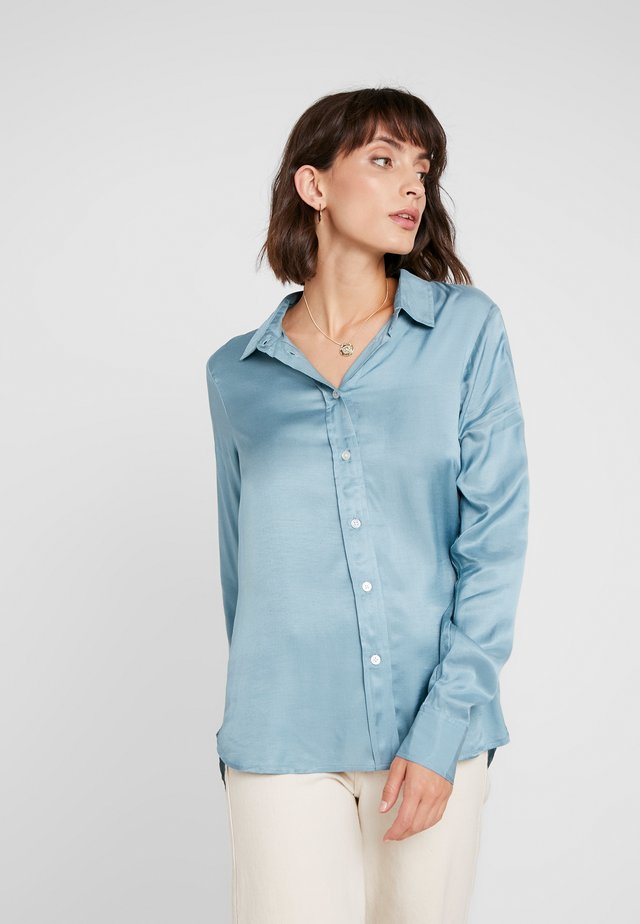 JEANETTE - Button-down blouse - smoke blue