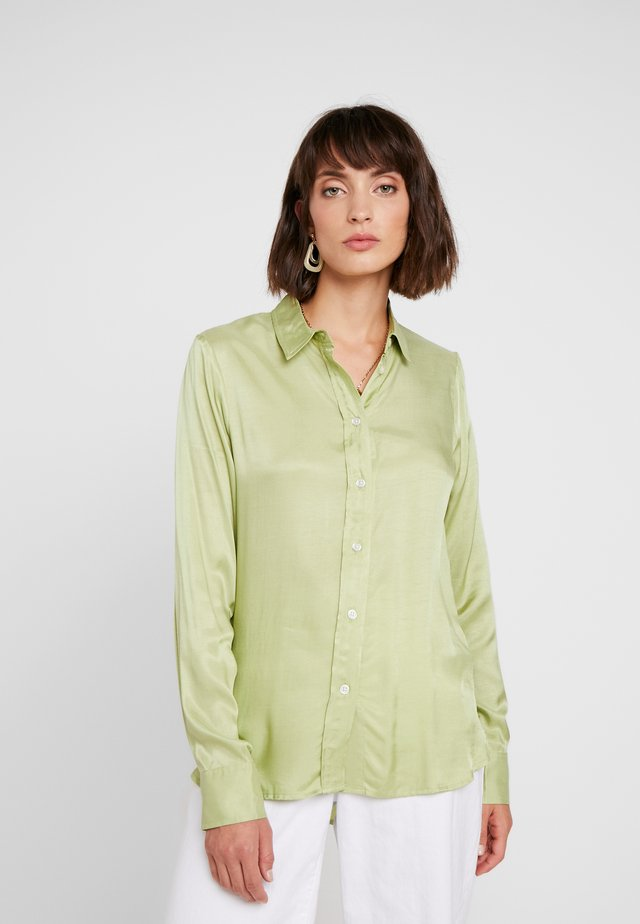 JEANETTE - Button-down blouse - nile