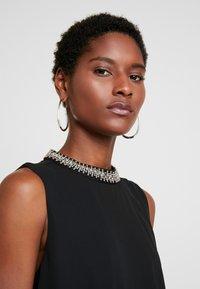 s.Oliver BLACK LABEL - Koktejlové šaty/ šaty na párty - true black - 4