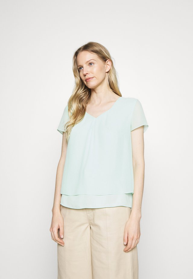 KURZARM - Blouse - misty green