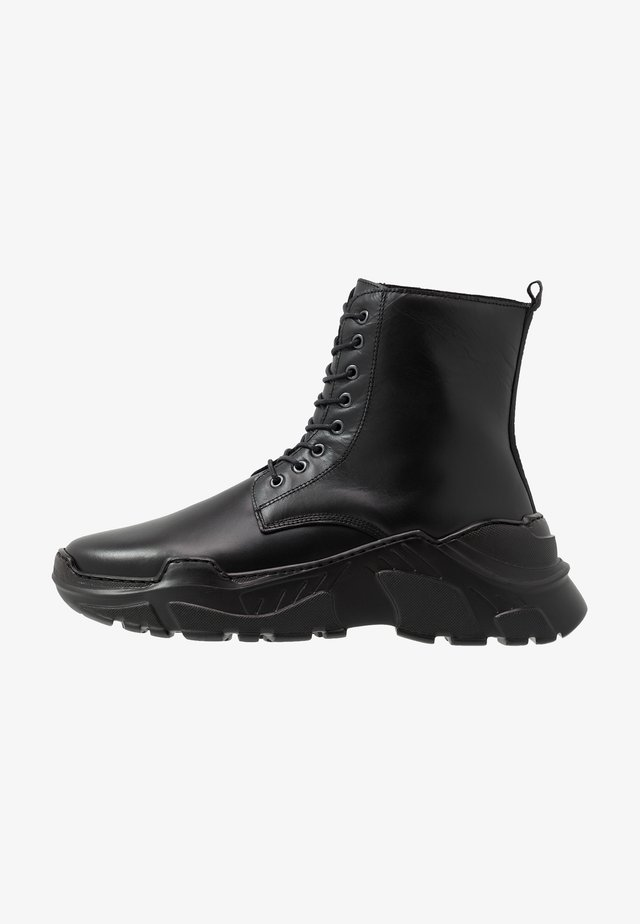 ZURG - Lace-up ankle boots - black polido