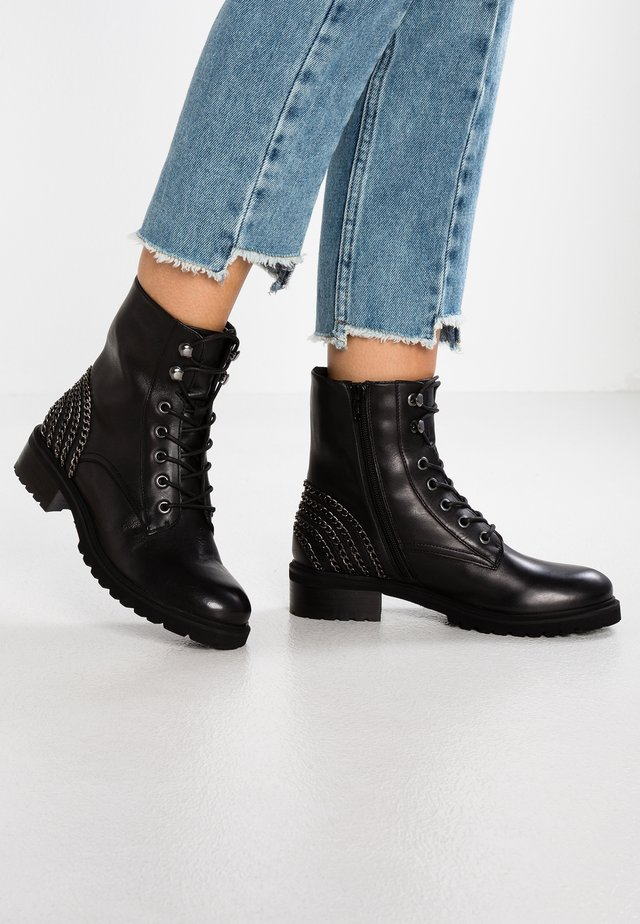 LOYANDA - Cowboy/biker ankle boot - black