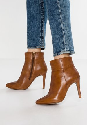 NOLI - High heeled ankle boots - cognac
