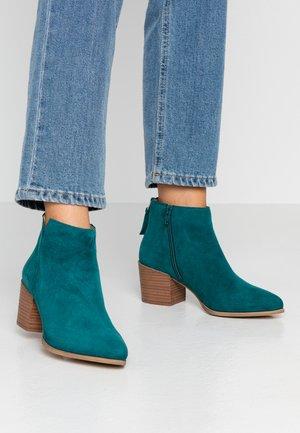 NEVA - Ankle boots - bottle green