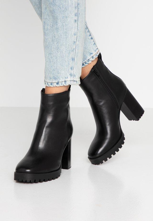 JONNIE - High heeled ankle boots - black