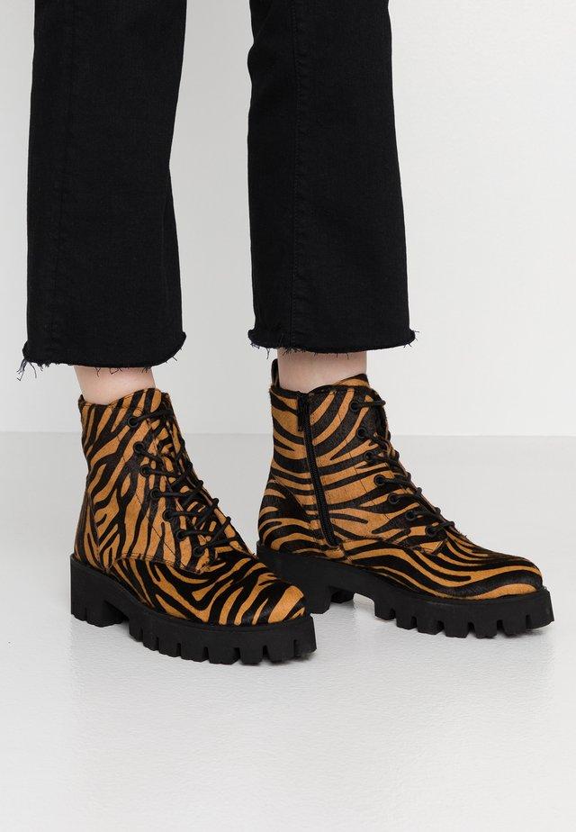 ARIANNE - Platform ankle boots - brown