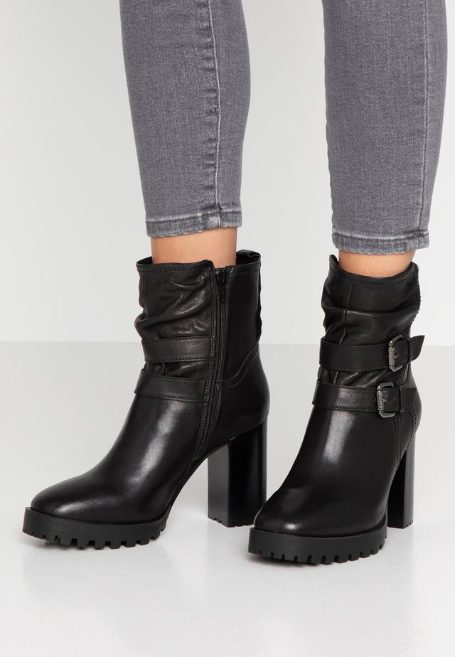 JOREA - Cowboy/biker ankle boot - black