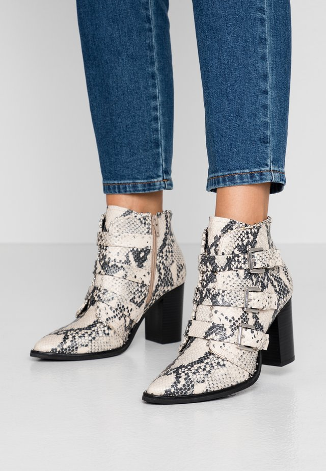 HUBLE - High heeled ankle boots - natural