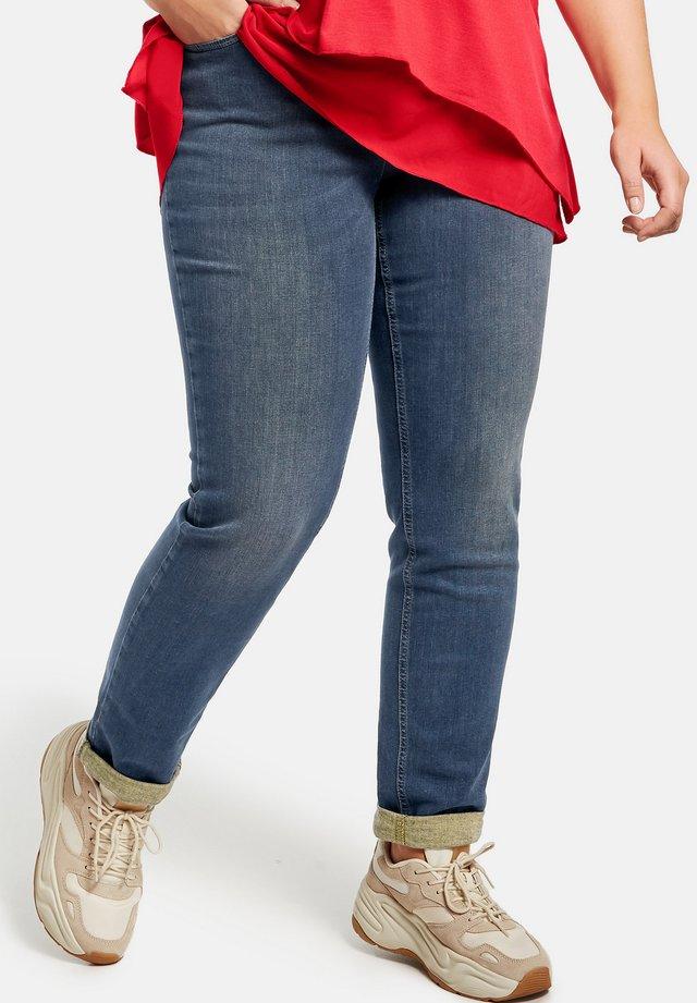 BETTY  - Slim fit jeans - dark blue denim