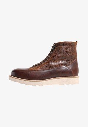 QUICK - Lace-up ankle boots - cognac