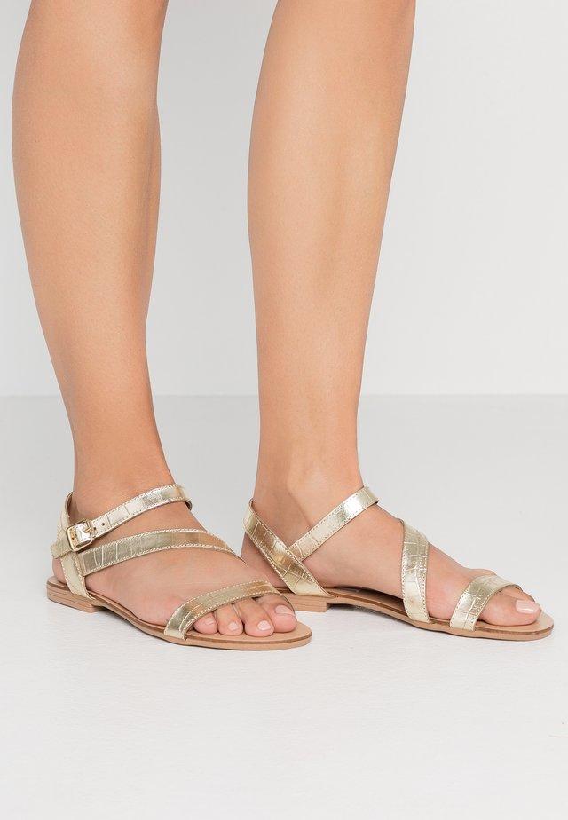 CARITA - Sandały - gold