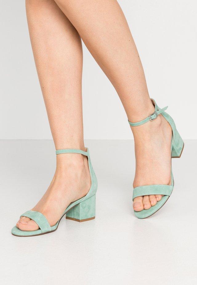 IRENEE - Sandaalit nilkkaremmillä - mint