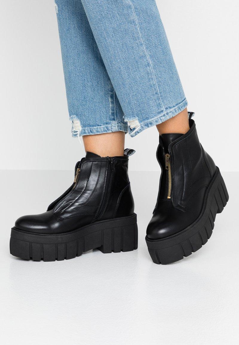 Steve Madden - FINNE - Platform ankle boots - black