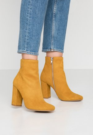 PIXIE - High heeled ankle boots - mustard