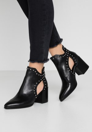 JUSTINE - Ankle boot - black