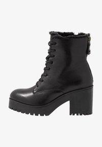 Steve Madden - SAMANTHA - Platform ankle boots - black - 1