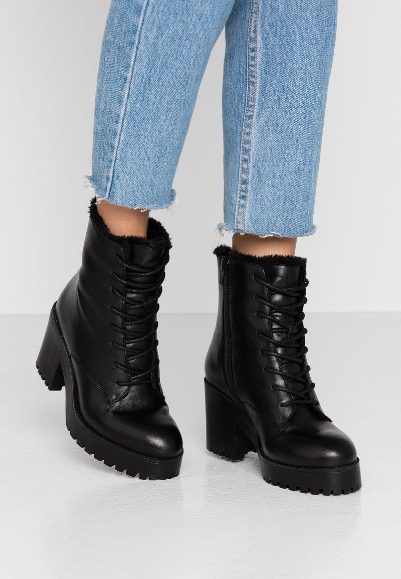 Steve Madden - SAMANTHA - Platform ankle boots - black
