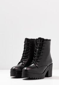 Steve Madden - SAMANTHA - Platform ankle boots - black - 4
