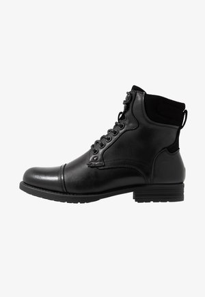 RAWSON - Šněrovací kotníkové boty - black