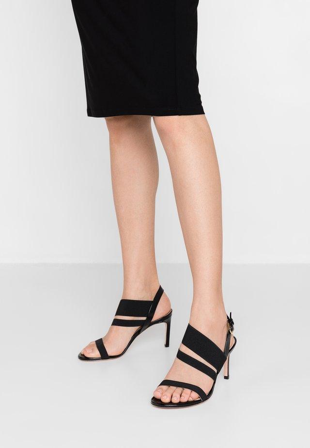 ADRIENNE - Sandalen met hoge hak - black