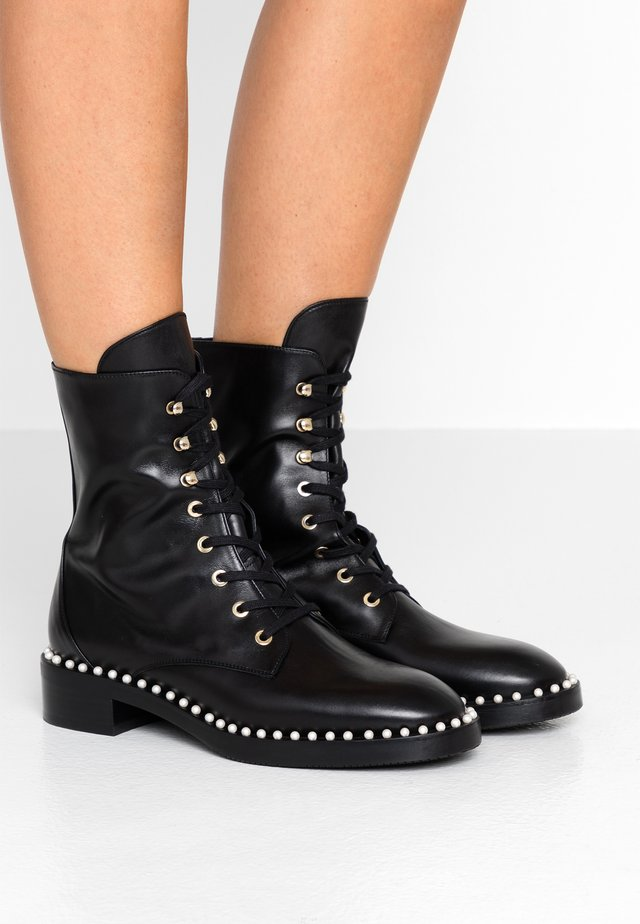 SONDRA - Lace-up ankle boots - black