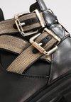 Steffen Schraut - CHAIN ROAD - Cowboy/biker ankle boot - black/gold