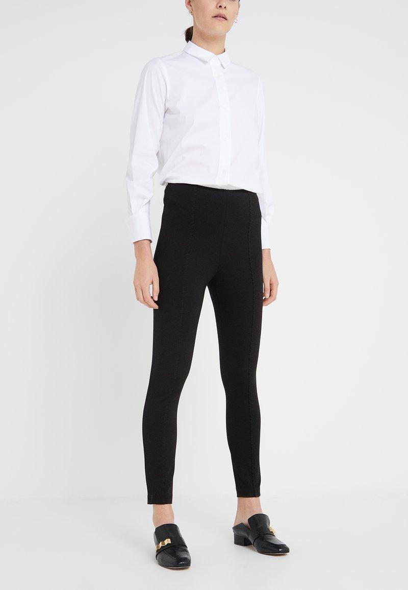 Steffen Schraut - CAROLINE ESSENTIAL PANTS - Leggings - Trousers - black