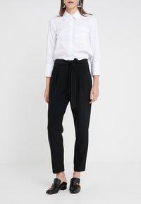 Steffen Schraut - PRISCILLA MODERN PANTS - Trousers - black - 0