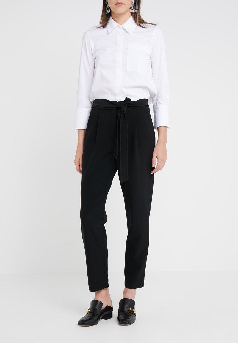 Steffen Schraut - PRISCILLA MODERN PANTS - Trousers - black