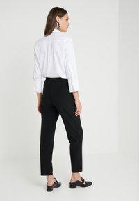 Steffen Schraut - PRISCILLA MODERN PANTS - Trousers - black - 2