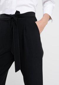 Steffen Schraut - PRISCILLA MODERN PANTS - Trousers - black - 5