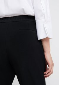Steffen Schraut - PRISCILLA MODERN PANTS - Trousers - black - 3