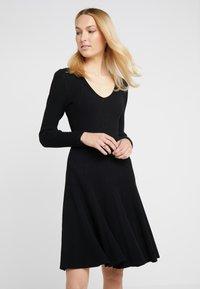 Steffen Schraut - DRESS SPECIAL - Pletené šaty - black - 0